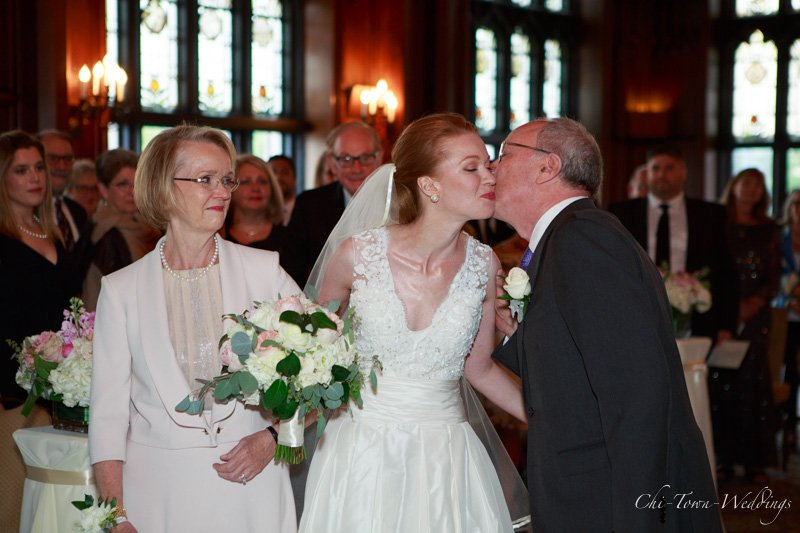 Candid Bride kissing her father at the alter
