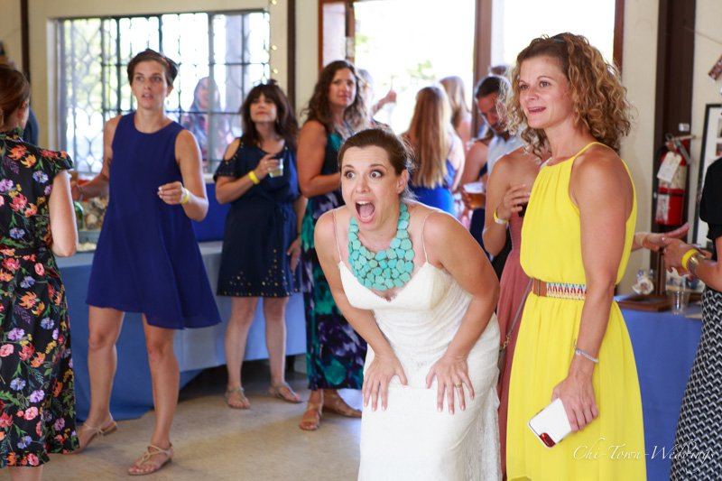 Bride laughing at speech candid