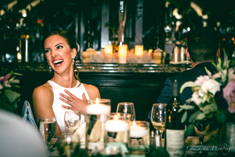 Bride laughing candidly during speech