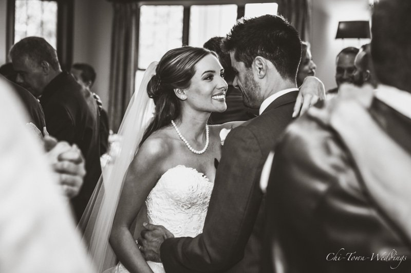 Candid Bride and Groom dancing together