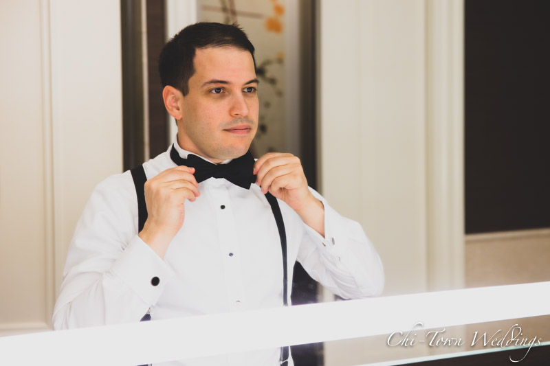 www.Chi-Town-Weddings.com  Groom fixing tie in mirror