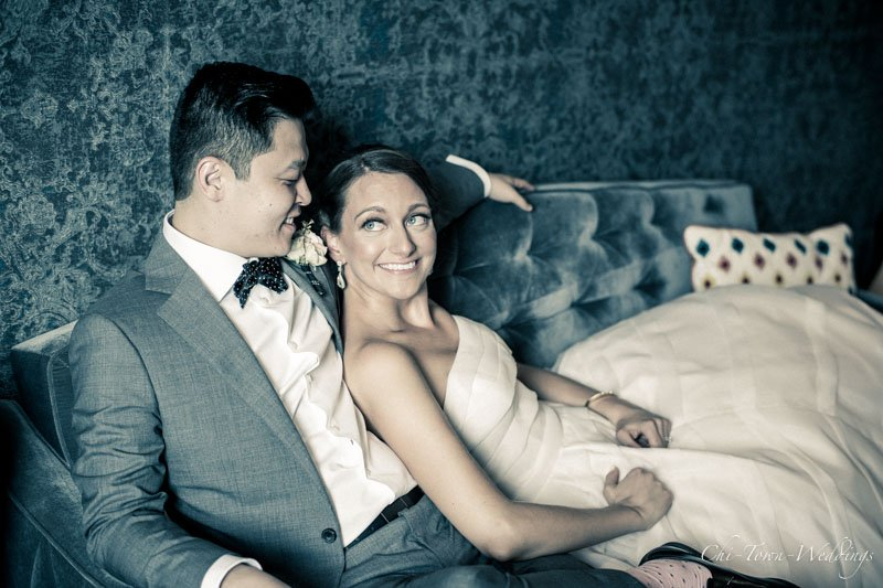 Bride and Groom posing on a couch