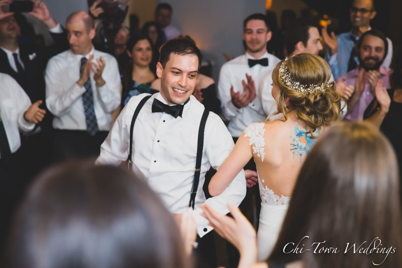 www.Chi-Town-Weddings.com  Bride and groom dancing with a crowd