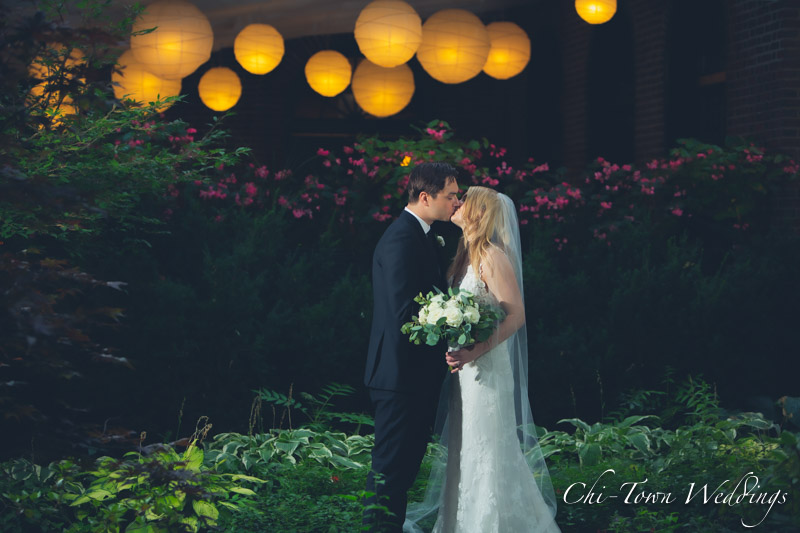 www.Chi-Town-Weddings.com Bride and Groom kissing in garden