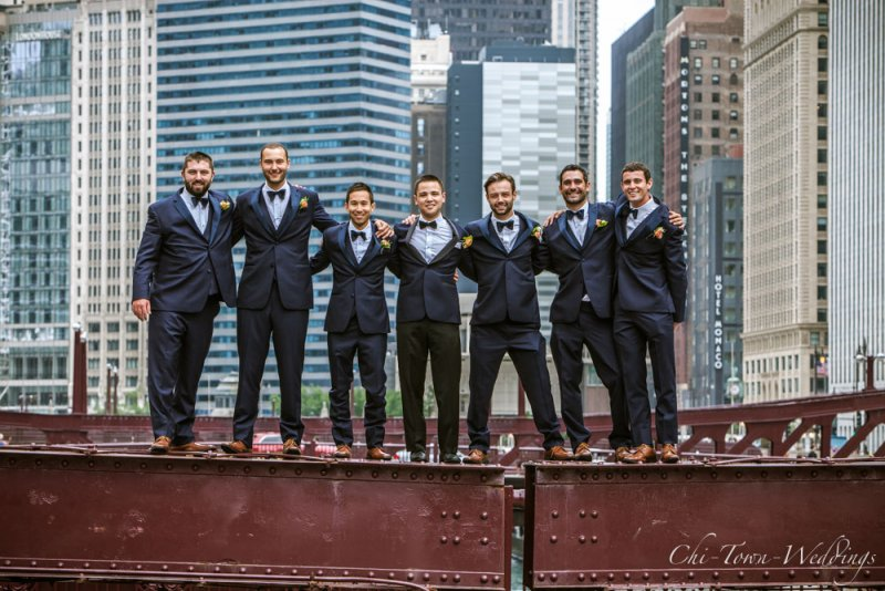 Groomsmen standing on the Lasalle Street Bridge in Chicago