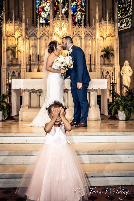 www.Chi-Town-Weddings.com  Bride and Groom Kissing, little girl covering eyes